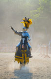 Shining Knight. An armored knight on horseback with yellow and purple livery gestures to the audience on a tournament field Stock Photography