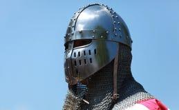Shining knight helmet. Image of a templar knight helmet against a blue sky.Natural lighting Royalty Free Stock Images