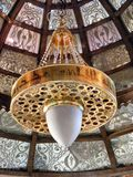 Shining lantern in khan el khalili souq market with Arabic handwriting on it in egypt cairo Stock Photo