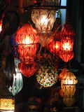 Shining lanterns in khan el khalili souq market with Arabic handwriting on it in egypt cairo. Vendor selling handmade copper oriental lamps ornaments in khan el Stock Image