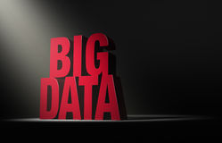 Shining A Light On Big Data. A single, angled spotlight reveals a red BIG DATA on a dark background Stock Photos