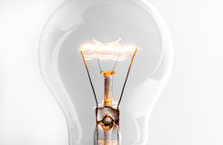 Free Shining Light Bulb Close Up On Bright Background Stock Photos - 52661513