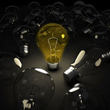 Shining lightbulb among other lightbulbs Royalty Free Stock Images