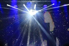 Bright shining white lights at concert stage. Shining lights on blue background at outdoor stage on the main square of Varna city,Bulgaria,New Year Eve December royalty free stock photos