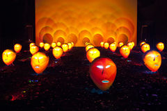 Shining masks of furious crowd. The shining masks of furious crowd during the holiday Light circle in Moscow Stock Image