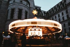 A shining merry go around fast movement at a carnival stock image