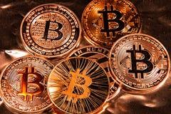 BTC Bitcoin coins. Shining metal BTC bitcoin coins in gold tint Stock Image