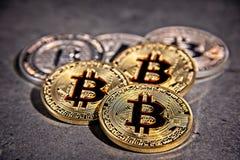 BTC Bitcoin coins. Shining metal BTC bitcoin coins on grey background Royalty Free Stock Photography