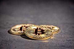BTC Bitcoin coins. Shining metal BTC bitcoin coins on grey background Stock Photos