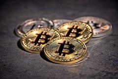 BTC Bitcoin coins. Shining metal BTC bitcoin coins on grey background Royalty Free Stock Image