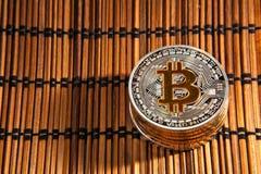 BTC Bitcoin coins. Shining metal BTC bitcoin coins on wood mat Stock Photography