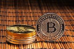 BTC Bitcoin coins. Shining metal BTC bitcoin coins on wood mat Royalty Free Stock Photography