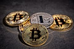 BTC Bitcoin coins. Shining metal BTC bitcoin and litecoin coins on grey background Royalty Free Stock Images