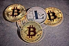 BTC Bitcoin coins. Shining metal BTC bitcoin and litecoin coins on grey background Stock Photo