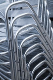 Shining metal chairs are stacked Royalty Free Stock Photography