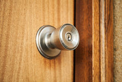 Shining metal door handle with keyhole, closeup Stock Photography