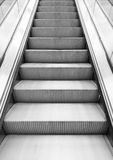 Shining metal escalator moving up, vertical photo Royalty Free Stock Images