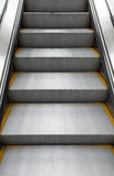 Shining metal escalator moving up, vertical photo Stock Images