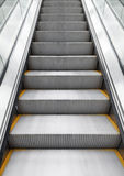 Shining metal escalator moving up, vertical photo Royalty Free Stock Image