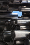 Shining metal tubes, abstract industrial background Stock Photography