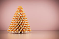 Shining modern Christmas tree on rose gold wall background. Royalty Free Stock Images