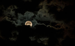 The shining Moon. The full moon fighting the clouds Royalty Free Stock Photos