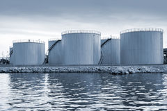 Shining oil tanks on the sea coast in Varna port Royalty Free Stock Photos