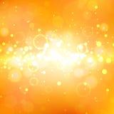 Shining orange background with light effects. Golden burst. Royalty Free Stock Image