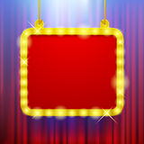 Shining party banner on red curtain background in blue light Royalty Free Stock Photography