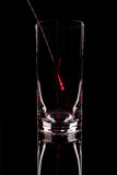The shining probe in an glass on a black background. The shining probe in an empty glass on a black background royalty free stock photo