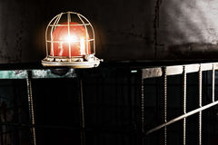 Shining red lamp on the iron cage Royalty Free Stock Photo