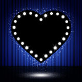 Shining retro heart on stage curtain Royalty Free Stock Photo