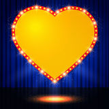 Shining retro heart on stage curtain Stock Image