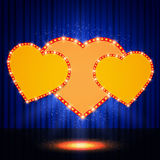 Shining retro heart on stage curtain Royalty Free Stock Photography