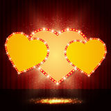 Shining retro heart on stage curtain Royalty Free Stock Photos