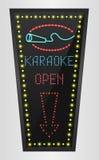 Shining retro light banner karaoke on a black background Stock Photos