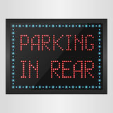 Shining retro light banner parking in rear on a black background Stock Images