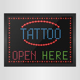 Shining retro light banner tattoo open here on a black background Stock Photography