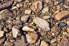 Shining ripples of transparent clear water on the river pebble Stock Image
