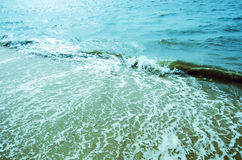 Shining ripples and waves on the surface of water for background Stock Photos