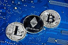 BTC LTC ETH Bitcoin Litecoin Ethereum coins on circuit board Stock Images