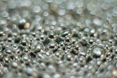 Shining silver silver drop drops balls abstract background, soft focus. Shining silver silver drop drops balls abstract background, christmas theme, soft focus stock image
