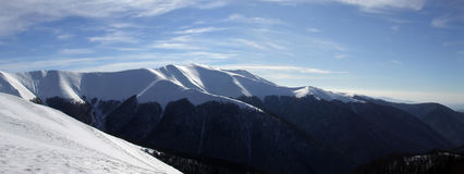Shining snow on the mountains. Splendid scenery of Carpathian mountains covered with snow Stock Photos