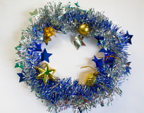 Shining and sparkling ribbon with fir tree toy inside. Blue ornament circle. Royalty Free Stock Images