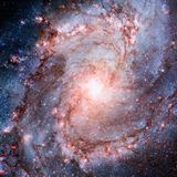 Shining spiral galaxy in space stock photo