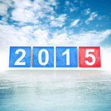 Shining squares with new 2015 year numbers. Blue and red shining squares with new 2015 year numbers on frosty cold winter background vector illustration