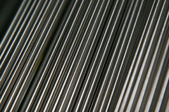 Shining Steel Pipes. Vertical view of small steel pipes stock photo