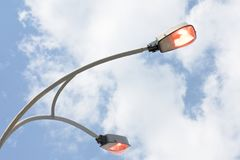 Shining street lamp over blue sky Royalty Free Stock Photography
