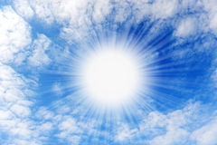 Shining sun with beams in the centre of clouds Stock Images
