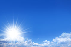 Shining sun on the blue sky. Royalty Free Stock Photos